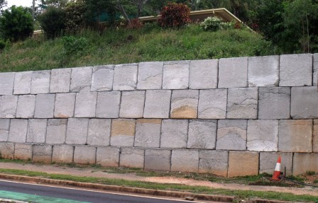 Retaining wall built with solid concrete blocks.