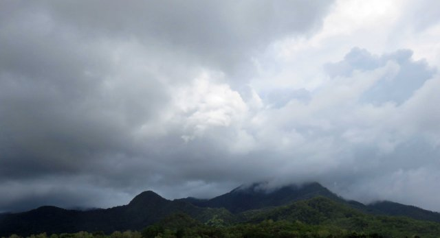 A common sight all around the world - cloud formation on the top of a hill or mountain. Near Edmonton, Cairns, Australia.