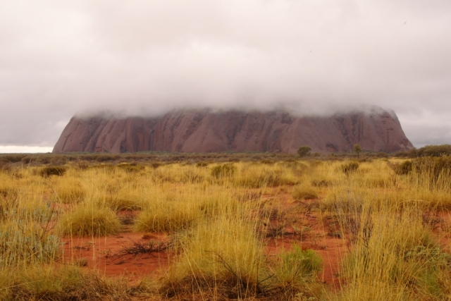 Storm brewing over the Rock. Ayer's Rock/Uluru, the largest monolith in the world. Photo: Bryan Clode.